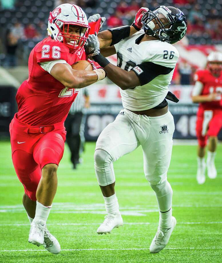 Katy running back Rodney Anderson, left, pushes away from Cibolo Steele defensive back Anthony Johnson during the first half of a high school football playoff game at NRG Stadium Saturday, Dec. 13, 2014, in Houston. ( Smiley N. Pool / Houston Chronicle ) Photo: Smiley N. Pool, Staff / Houston Chronicle / © 2014  Houston Chronicle
