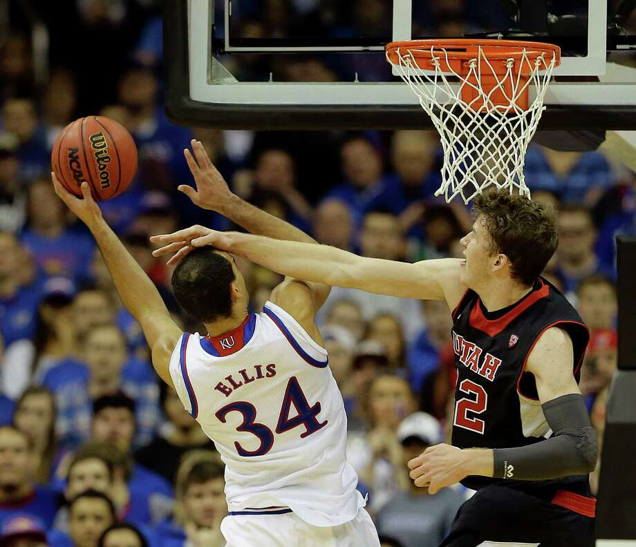Kansas' Perry Ellis, left, pays a price as he goes up for a shot against Utah's Jakob Poeltl in the second half of the No. 10 Jayhawks' win over the No. 13 Utes. Photo: Charlie Riedel, STF / AP