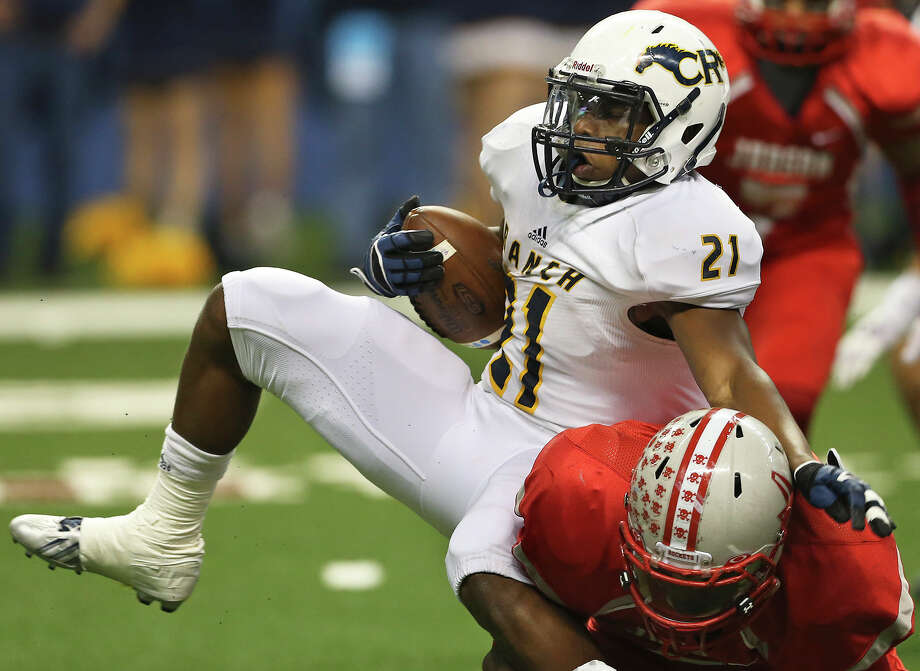 Cypress Ranch running back Charlie Booker tries to spin away from a Converse Judson defender during Saturday's Class 6A Division I semifinal game at the Alamodome in San Antonio. Photo: TOM REEL