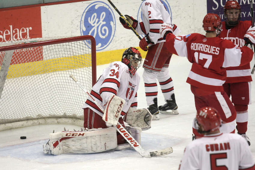 Dejected RPI goalie Scott Diebold reacts after Boston University's Brandon Hickey scores for BU during Saturday's game in Troy. (Ed Burke/Special to the Times Union)