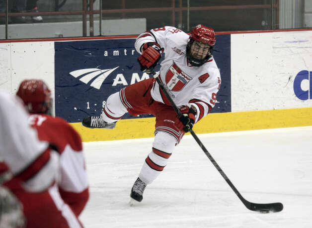 RPI's Matt Neal takes a shot during a power play during Saturday's game in Troy against Boston University. (Ed Burke / Special to the Times Union)