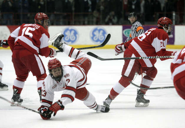 RPI's Jared Wilson is upended after tangling with Boston University's A.J. Greer during Saturday's game in Troy. (Ed Burke / Special to the Times Union)