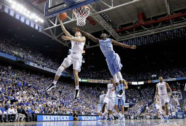 LEXINGTON, KY - DECEMBER 13:  Devin Booker #1 of the Kentucky Wildcats shoots the ball while defended by Theo Pinson #1 of the  North Carolina Tar Heels during the game at Rupp Arena on December 13, 2014 in Lexington, Kentucky.  (Photo by Andy Lyons/Getty Images) ORG XMIT: 519880413 Photo: Andy Lyons / 2014 Getty Images
