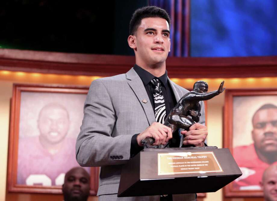 Marcus Mariota is the first in Oregon history, and the first Hawaiian, to win the trophy. His 90.92 percentage was second only to Troy Smith's 91.63 in 2006. Photo: Handout / 2014 The Heisman