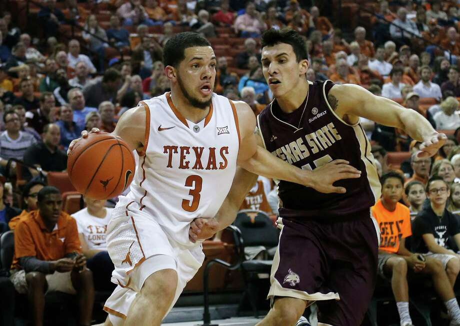 AUSTIN, TX - DECEMBER 13: Javan Felix #3 of the Texas Longhorns drives around Ethan Montalvo #15 of the Texas State Bobcats at the Frank Erwin Center on December 13, 2014 in Austin, Texas. Photo: Chris Covatta /Getty Images / 2014 Getty Images