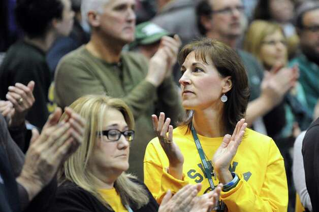 Debbie Rivers, mother of Deanna Rivers, left, and Regina Stewart, mother of Christopher Stewart, are part of a ceremony to honor their deceased children and raise awareness of distracted driving prior to the UAlbany vs. Siena basketball game on Saturday Dec. 13, 2014, at Times Union Center in Albany, N.Y. (Cindy Schultz / Times Union) Photo: Cindy Schultz / 00029844A