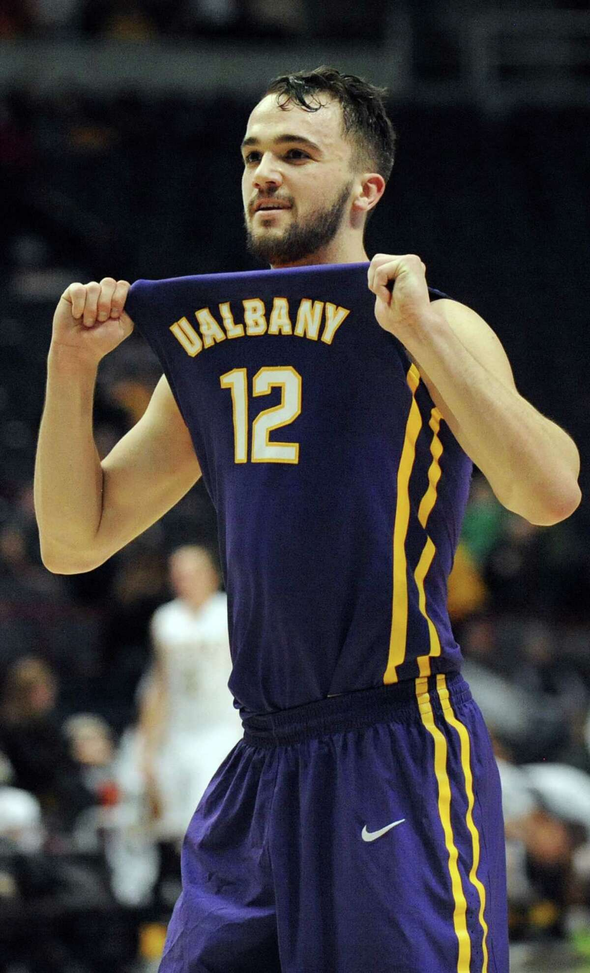 UAlbany's Peter Hooley shows his jersey to his fans when they win 77-68 over Siena during their basketball game on Saturday Dec. 13, 2014, at Times Union Center in Albany, N.Y. (Cindy Schultz / Times Union)
