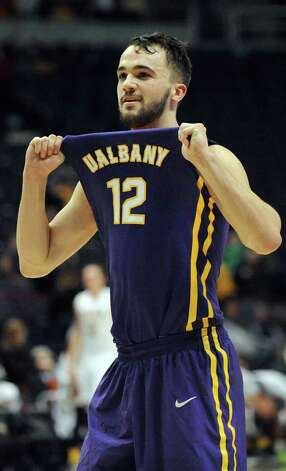 UAlbany's Peter Hooley shows his jersey to his fans when they win 77-68 over Siena during their basketball game on Saturday Dec. 13, 2014, at Times Union Center in Albany, N.Y. (Cindy Schultz / Times Union) Photo: Cindy Schultz / 00029816A