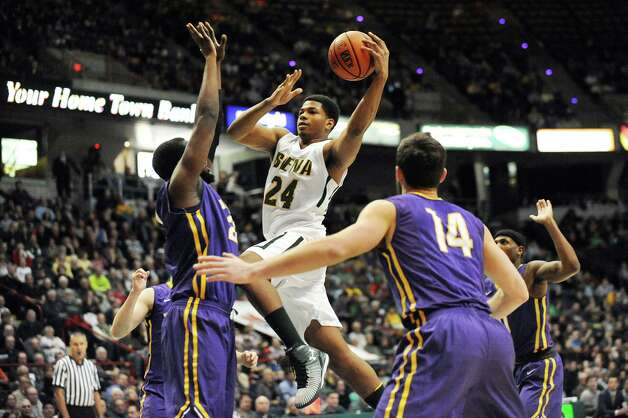 Siena's Lavon Long, center, goes to the hoop during their basketball game against UAlbany on Saturday Dec. 13, 2014, at Times Union Center in Albany, N.Y. (Cindy Schultz / Times Union) Photo: Cindy Schultz / 00029816A