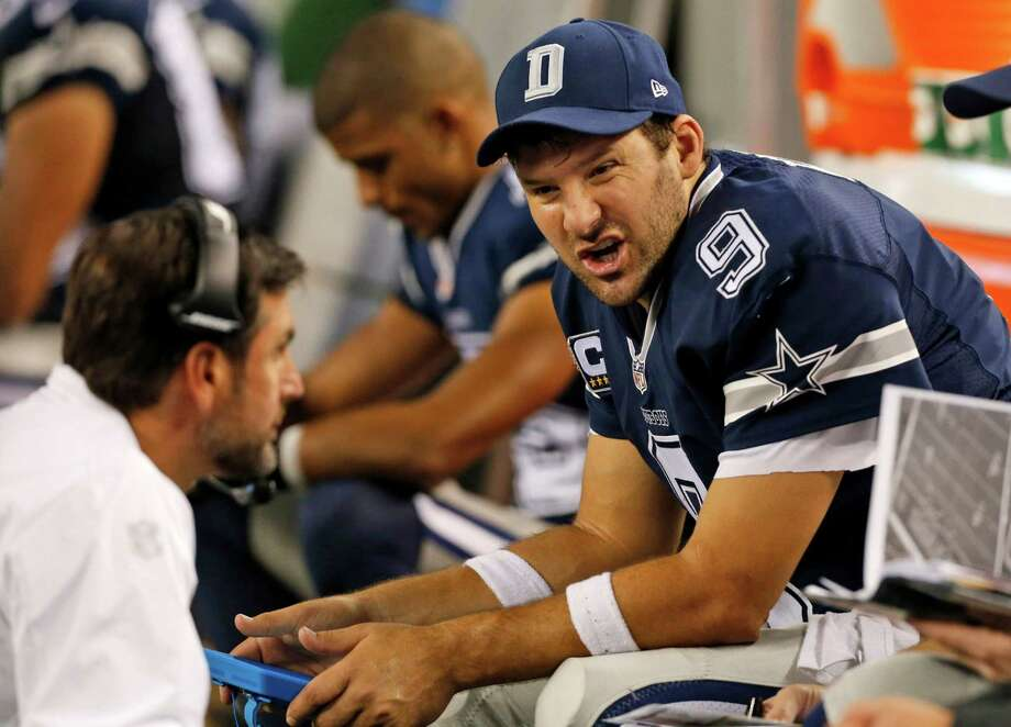Dallas Cowboys quarterback Tony Romo talks with wide receivers coach Derek Dooley during the second half against the Philadelphia Eagles in Arlington on Nov. 27. Photo: John F. Rhodes /Associated Press / FR170608 AP