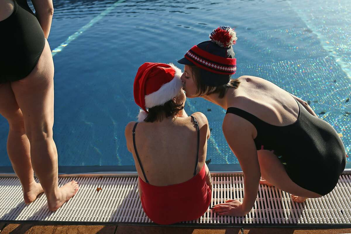 LONDON, ENGLAND - DECEMBER 13: Participants prepare to swim during the Outdoor Swimming Society's annual 'December Dip' at Parliament Hill Lido on December 13, 2014 in London, England. Around 400 people took part in the annual event competing in a range of different styles, with an award for the best dressed swimmer. (Photo by Dan Kitwood/Getty Images) *** BESTPIX ***