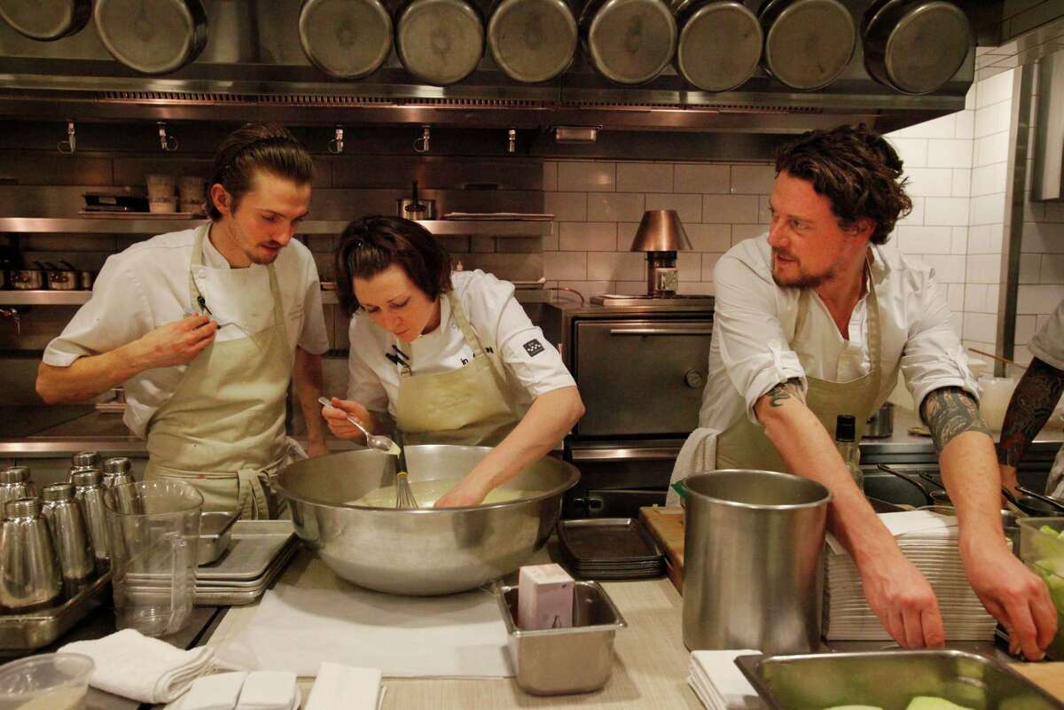 Guest Chef Kobe Desramaults, right, of In De Wulf works next to Rose Greene, center, his Creative Development Chef as she works with line cook Miles Pundsack-Poe, left, as they prep for dinner in The Restaurant at Meadowood Napa Valley during their annual Twelve Days of Christmas guest chef event Dec. 9, 2014 in St. Helena, Calif.