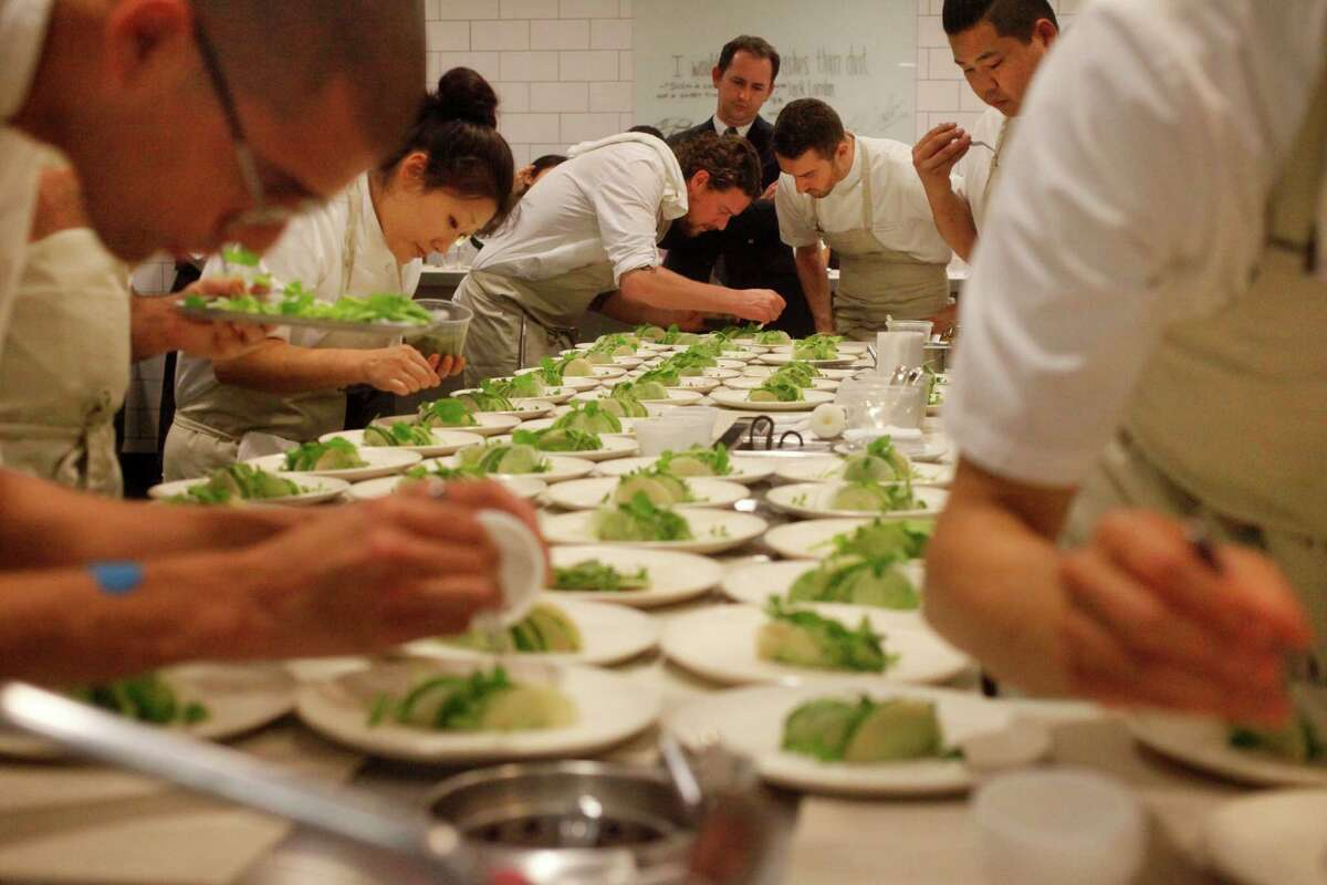 Guest Chef Kobe Desramaults, center, of In De Wulf, plates food with the help of the kitchen staff for dinner in The Restaurant at Meadowood Napa Valley during their annual Twelve Days of Christmas guest chef event Dec. 9, 2014 in St. Helena, Calif.