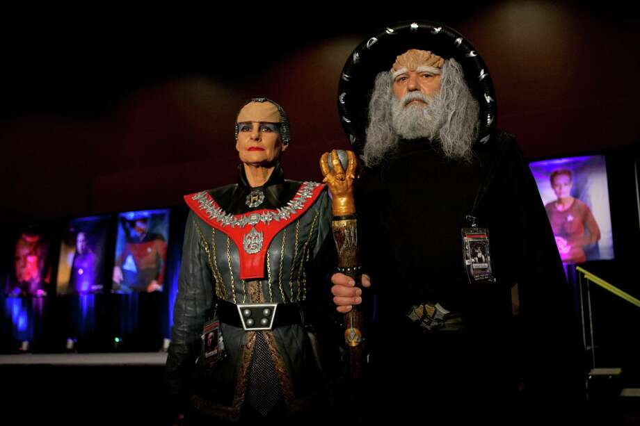 """Kent Bass (right) and Chris Bass (left) of Yelm won first place in Star Trek Convention's costume contest dressed as the """"Klingon Judge"""" and """"Azetbur"""" in Bellevue on Saturday, Dec. 13, 2014. Photo: ANNA ERICKSON, SEATTLEPI.COM / SEATTLEPI.COM"""