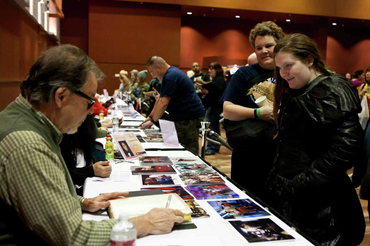 Nikita Steele, 16, shows actor Jonathan Frakes her shooting script for