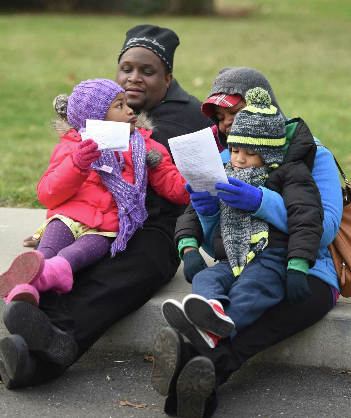 Clive and Kharline Haynes, of Stamford, watch the live nativity at First United Methodist Church in Stamford, Conn. with their kids Rylie, 6, and Dash, 4, Sunday, Dec. 14, 2014. Children dressed up and portrayed Mary, Joesph and others from the Bible, with live animals, as a large group watched and sang Christmas carols.