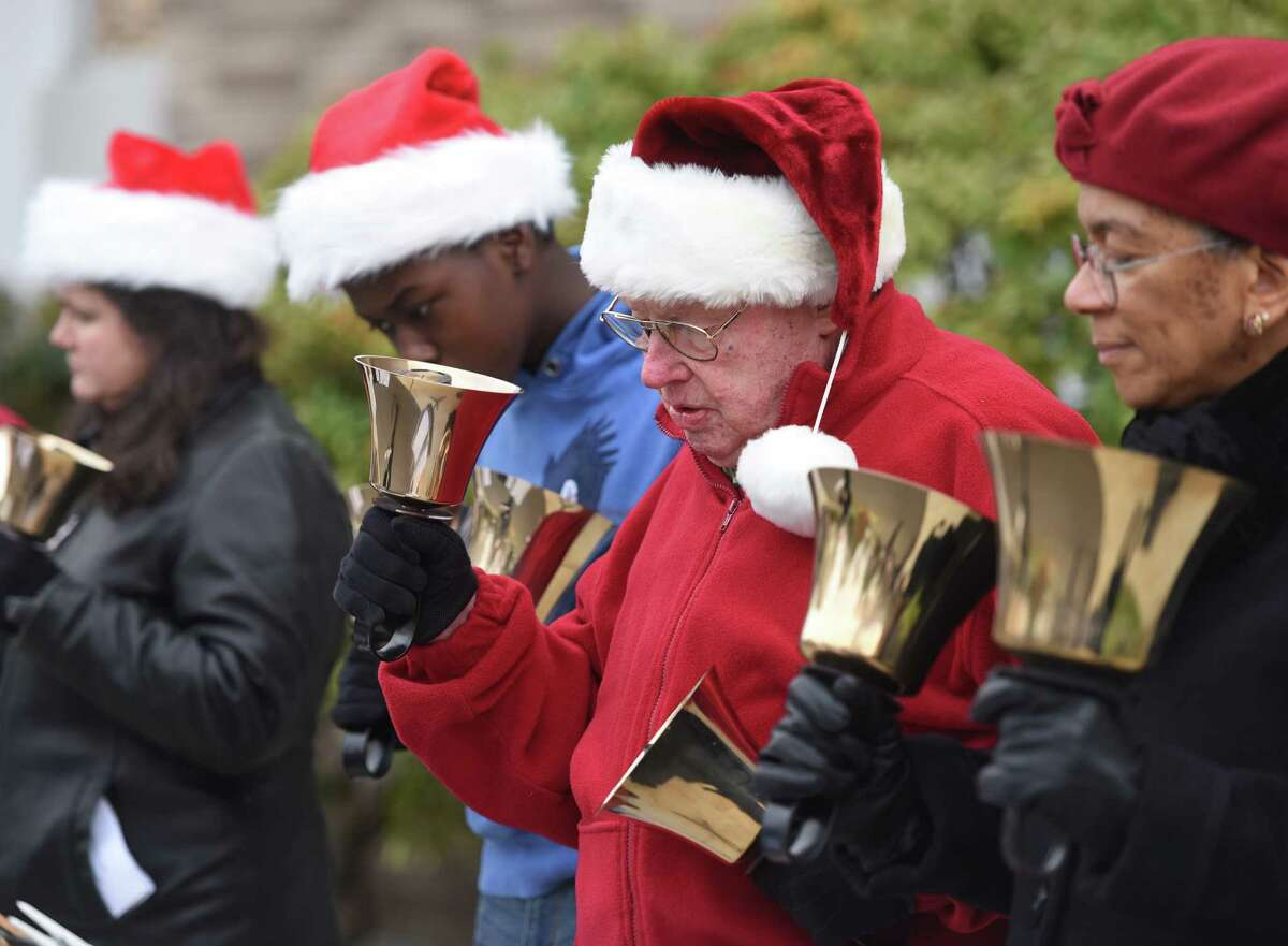 Fred Stunkel and others play the bells during the live nativity at First United Methodist Church in Stamford, Conn. Sunday, Dec. 14, 2014. Children dressed up and portrayed Mary, Joesph and others from the Bible, with live animals, as a large group watched and sang Christmas carols.