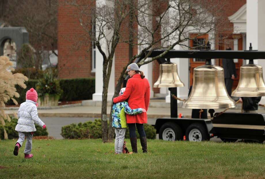 A series of bells are available for ringing outside St. Rose of Lima Catholic Church on the second anniversary of the Sandy Hook Elementary School killings in Newtown, Conn. on Sunday, December 14, 2014. Gov. Malloy attended the service. Photo: Brian A. Pounds / Connecticut Post