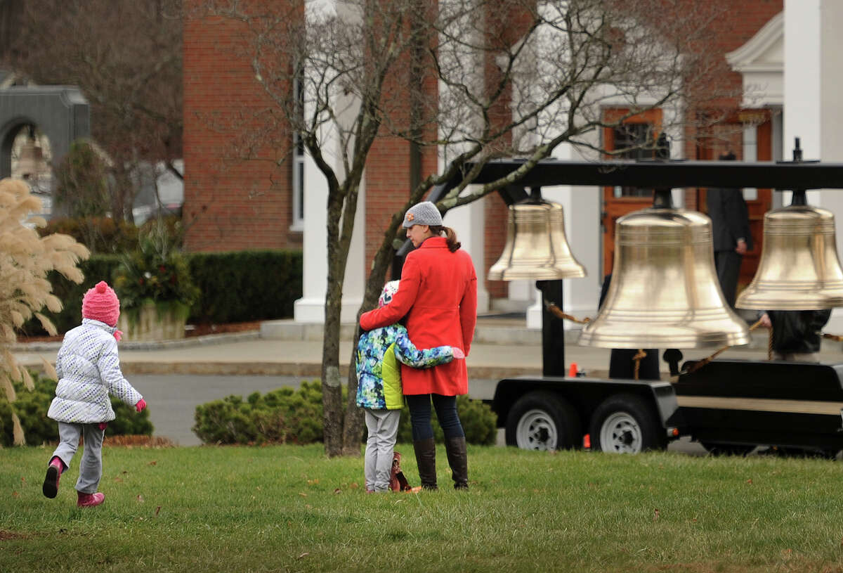 A series of bells are available for ringing outside St. Rose of Lima Catholic Church on the second anniversary of the Sandy Hook Elementary School killings in Newtown, Conn. on Sunday, December 14, 2014. Gov. Malloy attended the service.