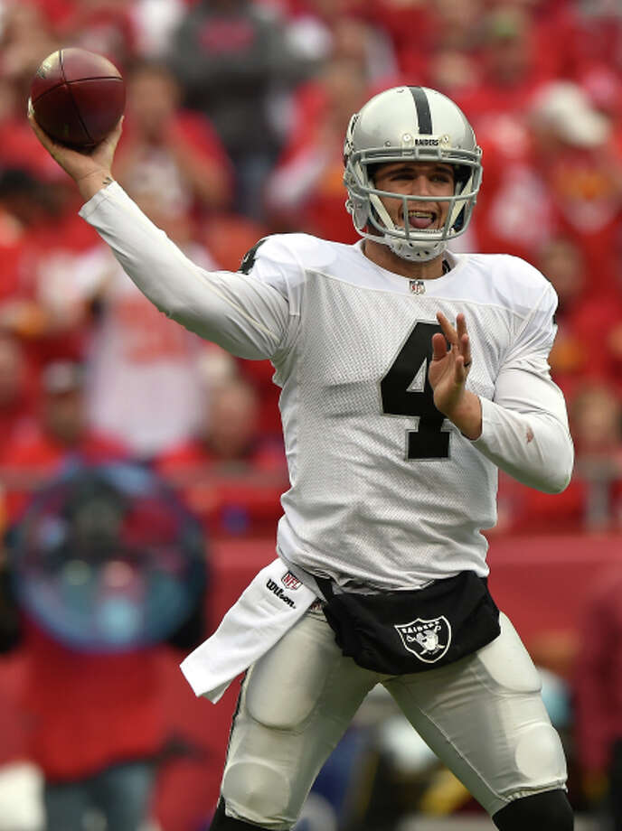 Derek Carr completed fewer than half of his passes. Photo: Peter Aiken / Getty Images / 2014 Getty Images