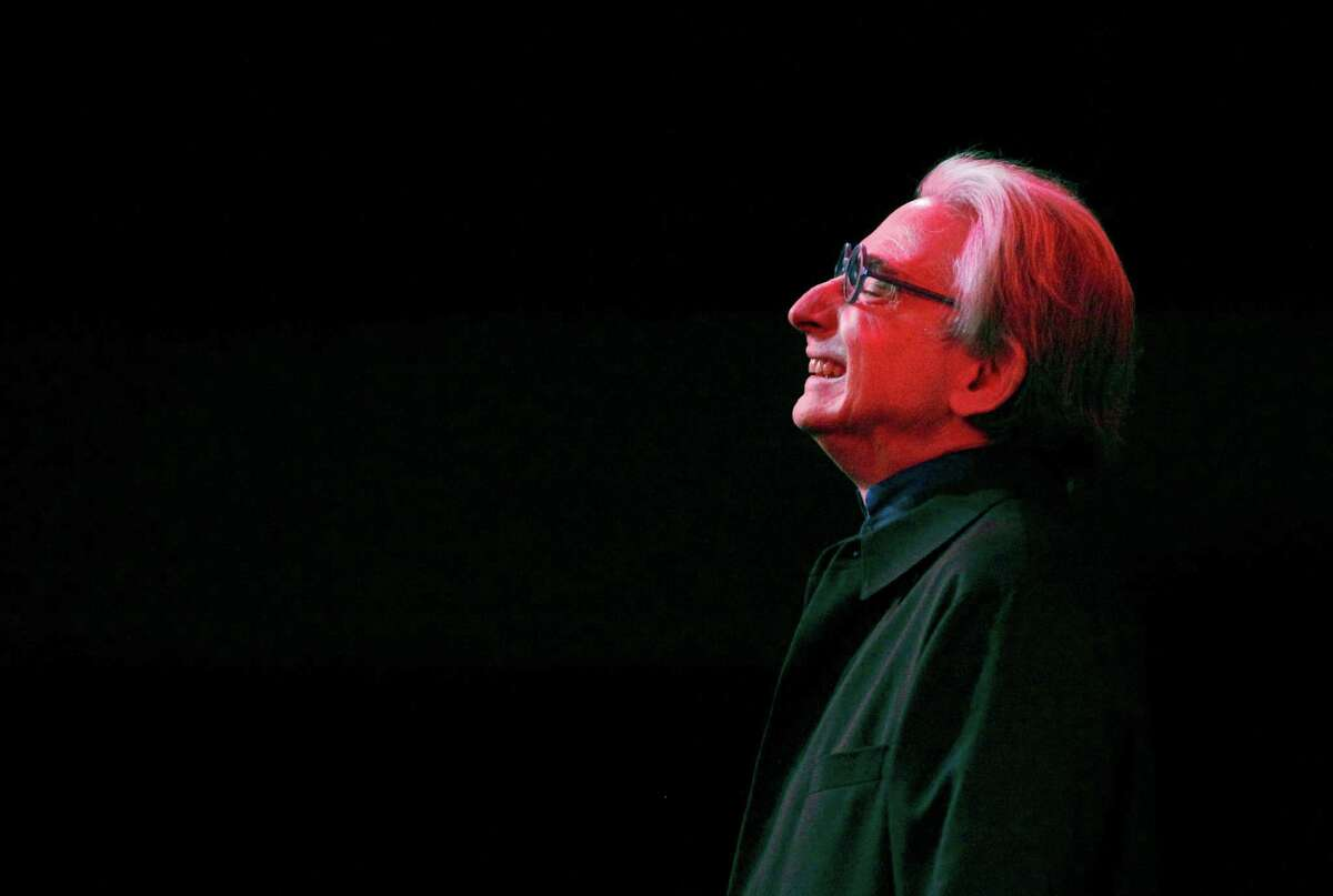 Michael Tilson Thomas bows after conducting symphony members during San Francisco Symphony's new performance series called Soundbox Dec. 13, 2014 in San Francisco, Calif.