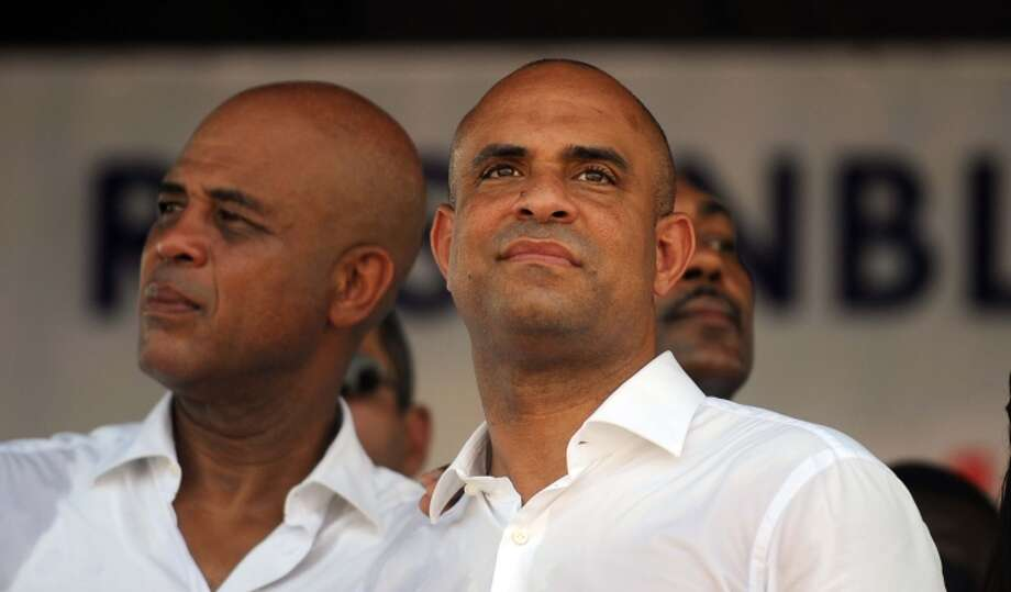Haitian President Michel Martelly (left) with Prime Minister Laurent Lamothe, who resigned Sunday. Photo: HECTOR RETAMAL / AFP/Getty Images / AFP