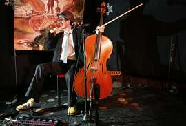 "Joey ""Cello Joe"" Chang prepares to play his classical hip hop set at the 50 Mason Social House in San Francisco, Calif."