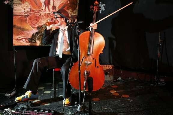"Joey ""Cello Joe"" Chang prepares to play his classical hip hop set at the 50 Mason Social House in San Francisco, Calif."