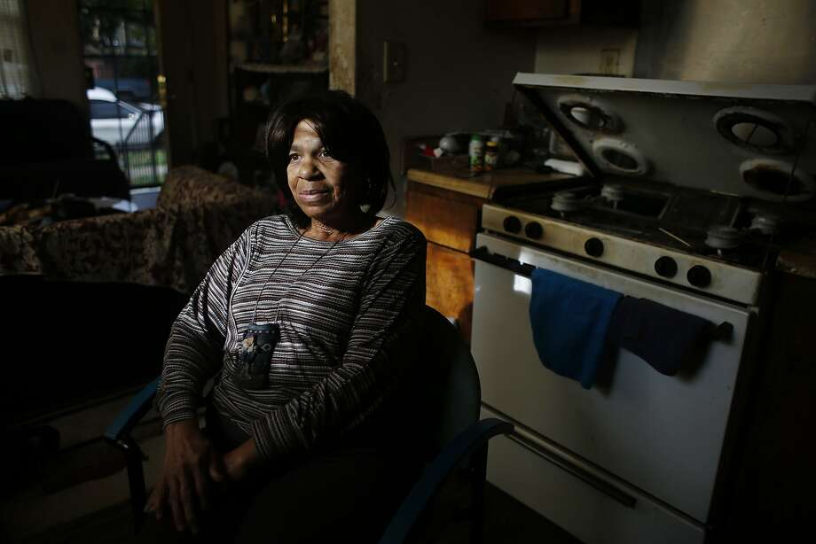 Caroline Calhoun, Nystrom Village resident, sits for a portrait next to the Kenmore stove in her home, which she says is prone to malfunction,  on Monday, December 8, 2014 in Richmond, Calif. Photo: Lea Suzuki, The Chronicle