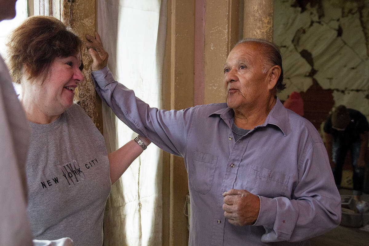 Miguel Calzada with JoAnne Comeaux in his home Saturday, Dec. 13, 2014 at the work party to clean out his home in preparation for renovations.
