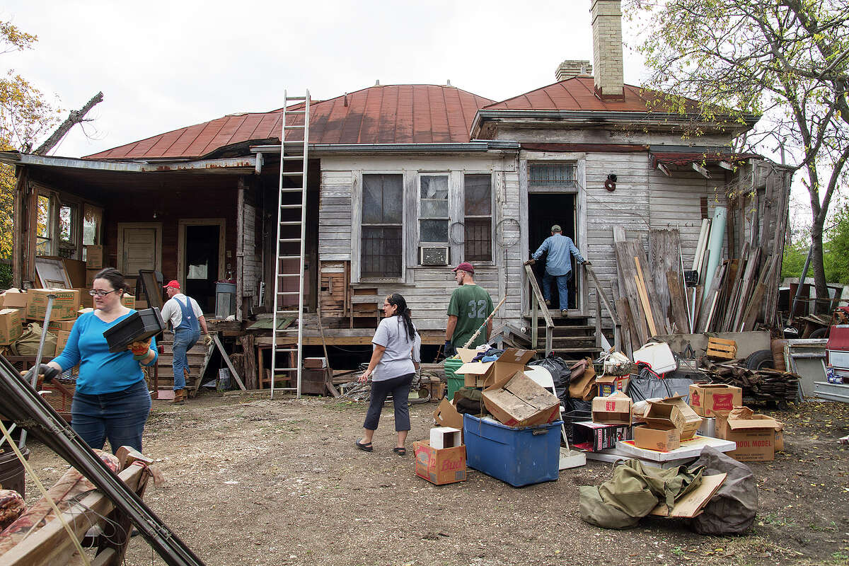 The back of Miguel Calzada's home, Saturday, Dec. 13, 2014. Volunteers helped clear out the home to prepare for renovations to the home.