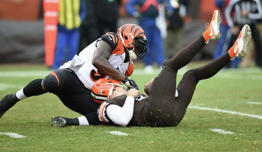 Cincinnati's Wallace Gilberry introduces Johnny Manziel to the FirstEnergy Stadium turf on a sack. Photo: Jason Miller / Getty Images / 2014 Getty Images
