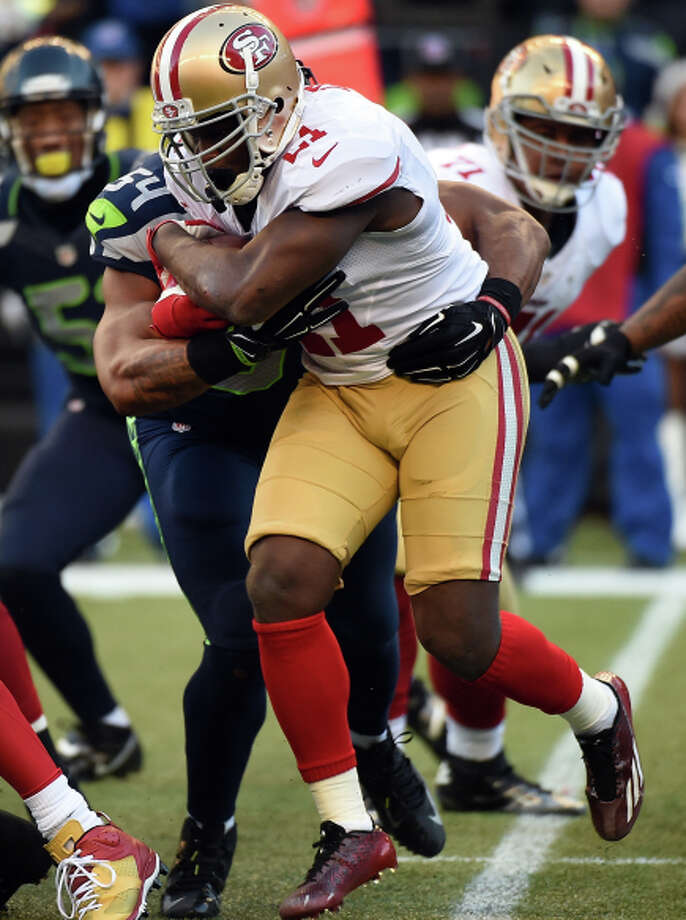 Frank Gore carries early before being lost to injury. Photo: Steve Dykes / Getty Images / 2014 Getty Images