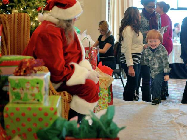 Kieran Loftfield, 4, of Duanesburg walks up to see Santa at the Brunch with Santa event at the Holiday Inn Express and Suites on Sunday, Dec. 14, 2014, in Latham, N.Y.  The event is put on by Big Crunch Media with sponsors Saratoga Sweets and JM Jewelers.  This was the second year of the annual event.  (Paul Buckowski / Times Union) Photo: Paul Buckowski / 00029852A