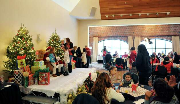 Families make their way up on to the stage to see Santa at the Brunch with Santa event at the Holiday Inn Express and Suites on Sunday, Dec. 14, 2014, in Latham, N.Y.  The event is put on by Big Crunch Media with sponsors Saratoga Sweets and JM Jewelers.  This was the second year of the annual event.  (Paul Buckowski / Times Union) Photo: Paul Buckowski / 00029852A