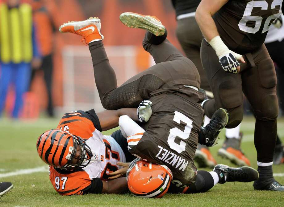 "Johnny Manziel has one of his numerous ""welcome to the NFL"" moments on Sunday, courtesy of a sack by Bengals defensive tackle Geno Atkins. Photo: David Richard, FRE / FR25496 AP"