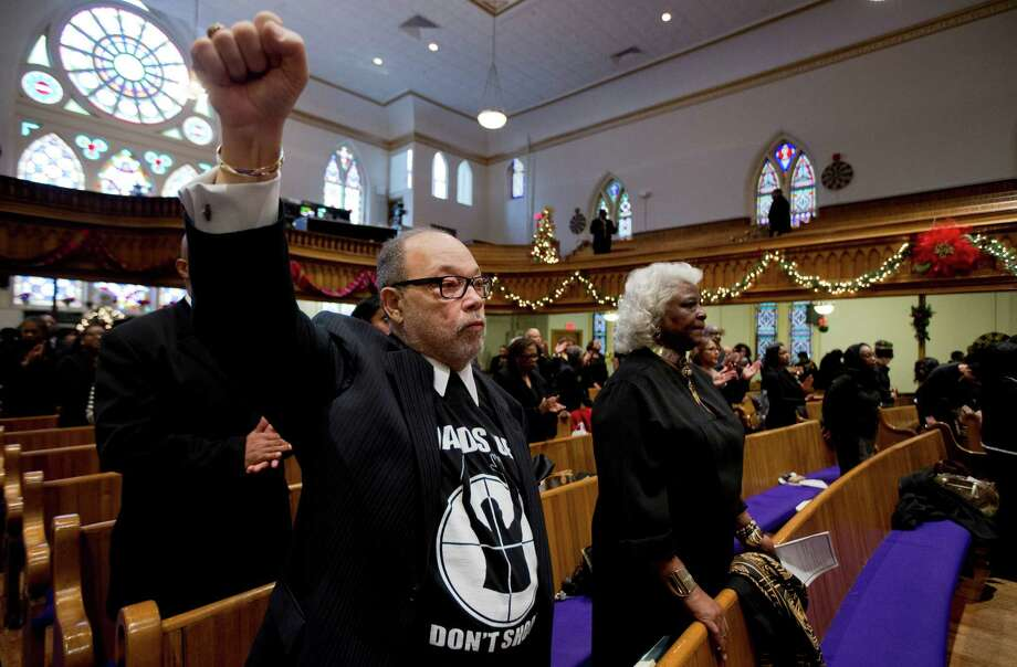 Church-goers across the country wore black to Sunday services in a symbolic stand against police shootings of unarmed black men.  Photo: Manuel Balce Ceneta, STF / AP