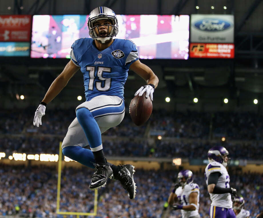 Golden Tate jumps for joy in the second quarter after his 7-yard hookup with Matthew Stafford cut the deficit to seven. Photo: Gregory Shamus / Getty Images / 2014 Getty Images