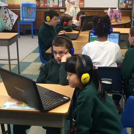 Third-graders from St. Jude the Apostle School in Wynantskill participate in the worldwide Hour Of Code initiative. Throughout the week, students at all grade levels, along with more than 70 million students all over the world, learned basic computer coding skills. (Kathy Vonk)