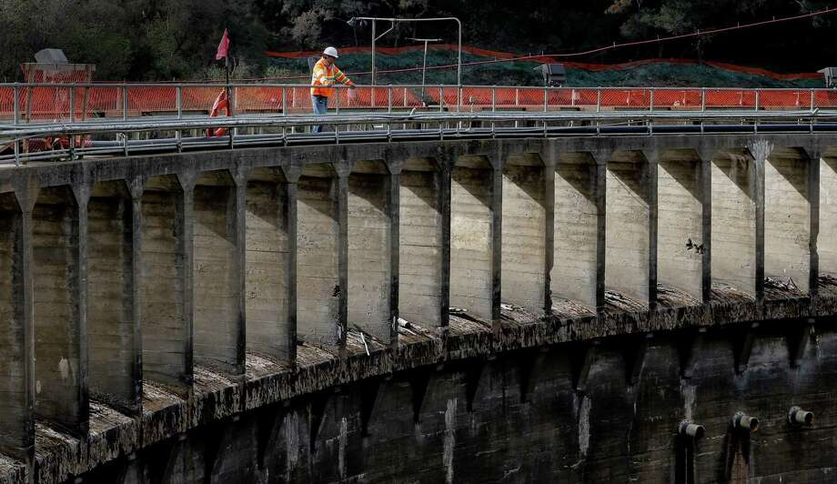 Project manager Aman Gonzalez, with California American Water looks out from the 106-foot-tall San Clemente Dam at the halfway point of the project to remove the dam and divert the Carmel River, near Carmel Valley Village, Calif., as seen on Wednesday Dec. 10, 2014. Photo: Michael Macor / The Chronicle / ONLINE_YES