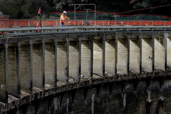 Project manager Aman Gonzalez, with California American Water looks out from the 106-foot-tall San Clemente Dam at the halfway point of the project to remove the dam and divert the Carmel River, near Carmel Valley Village, Calif., as seen on Wednesday Dec. 10, 2014.