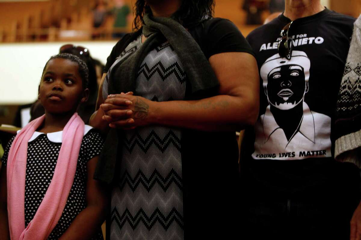 Families who have lost relatives to gun violence take part in a rally at Third Baptist Church in San Francisco, Calif., on Sunday, December 14, 2014.