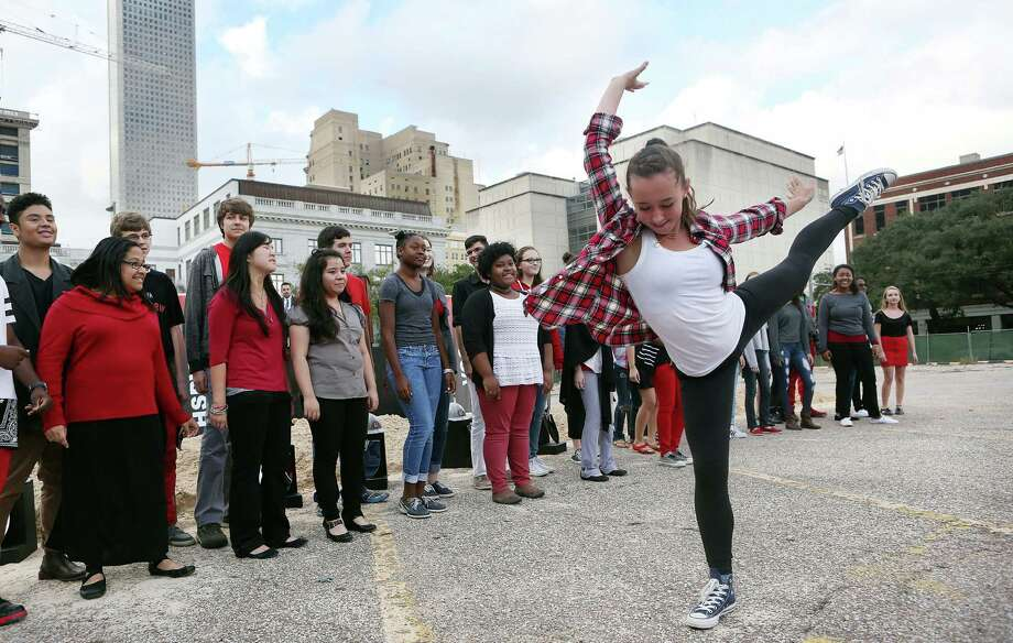 Students from the High School for the Performing and Visual Arts sing and dance at the ground-breaking ceremony on Sunday. Photo: Mayra Beltran, Staff / © 2014 Houston Chronicle