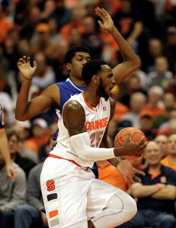 Syracuse's Rakeem Christmas, front, dribbles past Louisiana Tech's Leo Edwards in the first half an NCAA college basketball game in Syracuse, N.Y., Sunday, Dec. 14, 2014. (AP Photo/Nick Lisi) ORG XMIT: NYNL105 Photo: Nick Lisi / FR171024 AP