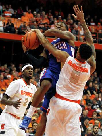 Louisiana Tech's Alex Hamilton, center, shoots under pressure from Syracuse's B.J. Johnson, left, and Chris McCullough, right, in the first half an NCAA college basketball game in Syracuse, N.Y., Sunday, Dec. 14, 2014. (AP Photo/Nick Lisi) ORG XMIT: NYNL104 Photo: Nick Lisi / FR171024 AP