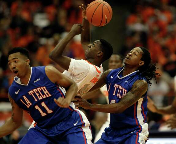 Syracuse's Kaleb Joseph, center, battles for the ball against Louisiana Tech's Xavian Stapleton, left, and Kenneth Smith, right, in the first half an NCAA college basketball game in Syracuse, N.Y., Sunday, Dec. 14, 2014. (AP Photo/Nick Lisi) ORG XMIT: NYNL102 Photo: Nick Lisi / FR171024 AP