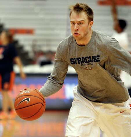 Syracuse's Trevor Cooney practices before an NCAA college basketball game against Louisiana Tech in Syracuse, N.Y., Sunday, Dec. 14, 2014. (AP Photo/Nick Lisi) ORG XMIT: NYNL101 Photo: Nick Lisi / FR171024 AP