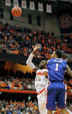Syracuse's Rakeem Christmas, left, shoots the game winning shot under pressure from Louisiana Tech's Michale Kyser, right, in the final second of an NCAA college basketball game in Syracuse, N.Y., Sunday, Dec. 14, 2014. Syracuse won 71-69. (AP Photo/Nick Lisi) ORG XMIT: NYNL106 Photo: Nick Lisi / FR171024 AP