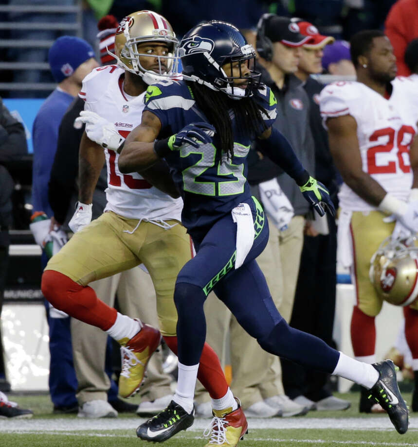 Seattle's Richard Sherman matches 49ers wide receiver Michael Crabtree stride for stride during the second half after Colin Kaepernick had earlier completed five straight passes to receivers in Sherman's coverage area. Photo: Elaine Thompson / Associated Press / AP