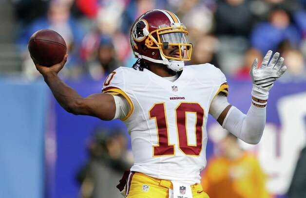 Washington Redskins quarterback Robert Griffin III (10) passes against the New York Giants during the second quarter of an NFL football game, Sunday, Dec. 14, 2014, in East Rutherford, N.J. (AP Photo/Julio Cortez)  ORG XMIT: ERU112 Photo: Julio Cortez / AP